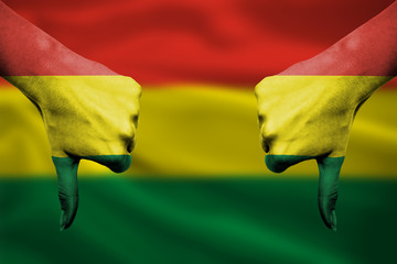 failure of Bolivia - hands gesturing thumbs down in front of fla