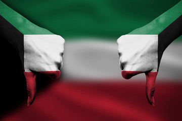 failure of Kuwait - hands gesturing thumbs down in front of flag