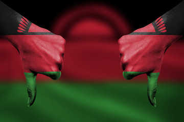 failure of Malawi - hands gesturing thumbs down in front of flag