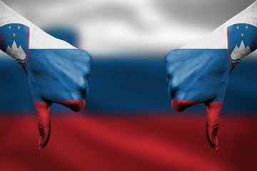 failure of Slovenia - hands gesturing thumbs down in front of fl