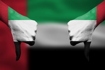 failure of United Arab Emirates - hands gesturing thumbs down in
