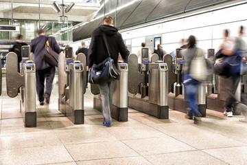 People walking into subway