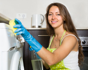Housewife cleaning washing machine