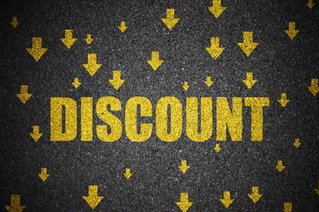 Discount and arrow sign down on asphalt