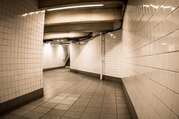 Empty tiled corridor in New York City Subway