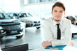 Handsome young man in dealership - 78995516