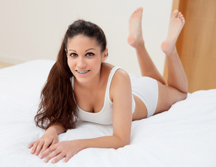 Young woman resting in her bed