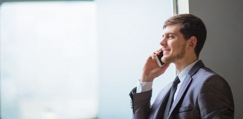 business man talking on cell phone at modern office