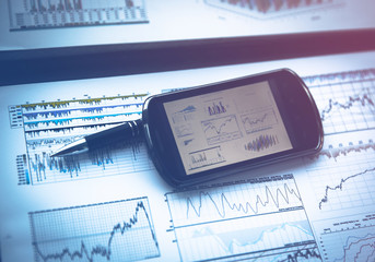 Business chart with smart phone and pen