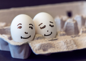 Concept of a couple in love, two eggs with painted faces