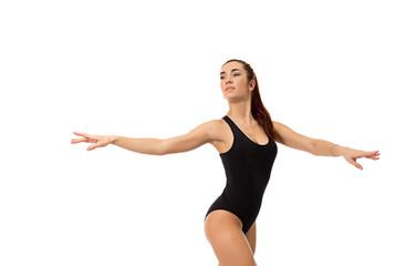 Dreamy female dancer posing at camera