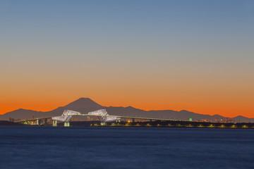 Tokyo bay at sunset with Tokyo gate bridge and Mountain Fuji .