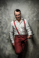 Man in red pants and white shirt.