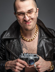 Man in skin coat holding photo camera