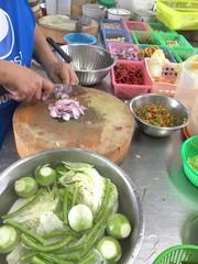 chop onion in kitchen.