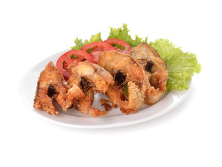 Fish dish - fried fish fillet with vegetables on white backgroun