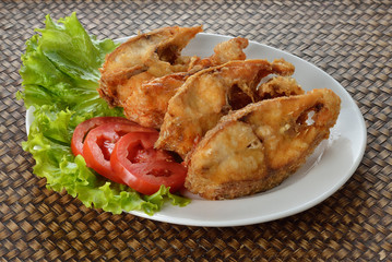 Delicious battered fish on a plate with chips