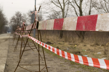 Cordon around a construction site - red tape