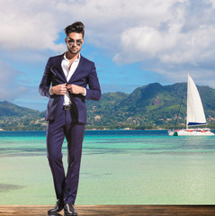 business man standing on the shore of the sea