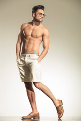Full body picture of a shirtless man posing