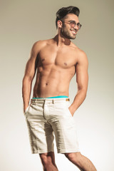 Hot sexy casual man smiling away from the camera