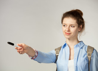 Attractive student  pointing at something with marker