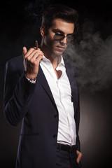 Handsome elegant business man looking down