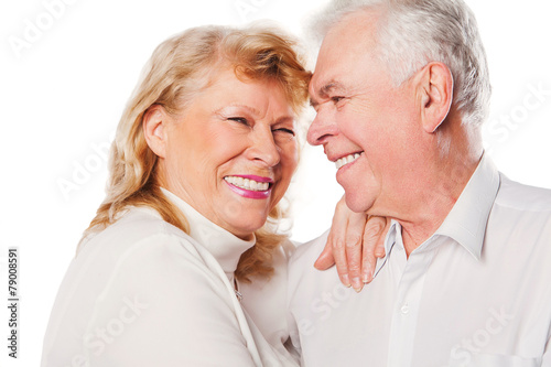 Close up of happy senior couple in love. Isolated over white - 79008591