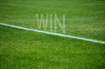 Football Win text on grass with white lane