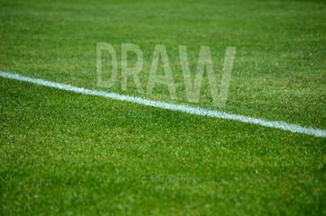 Football draw text on grass with white lane