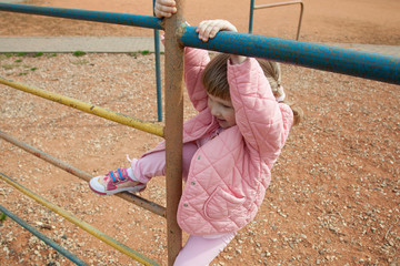 Active little girl playing outdoors