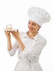 Beautiful woman chef cook showing a cake