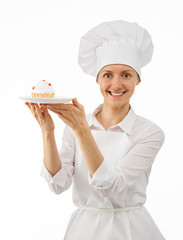 Beautiful woman chef cook showing cake
