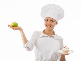 Woman cook chooses between an apple and a cake