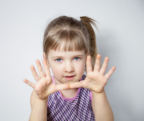 Pretty little girl showing her palms