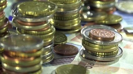 Euro Banknotes and Coins (dolly shot)