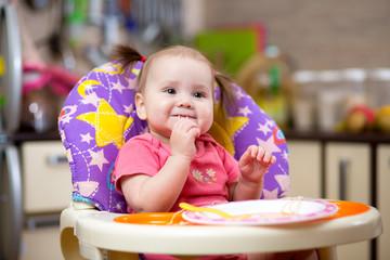 Pretty child toddler eating spaghetti