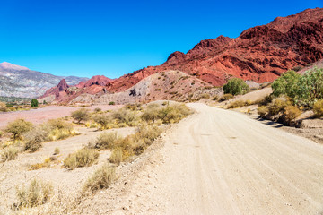 Dirt Road and Red Desert Hills in Bolivia