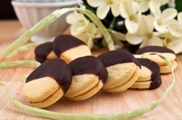 Biscuits filled with jam and covered with chocolate