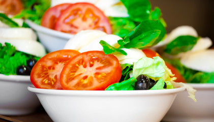 Italian salad from cherry tomatoes, a mozzarella and lettuce in