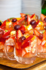 Berry drink in cups with fresh fruit