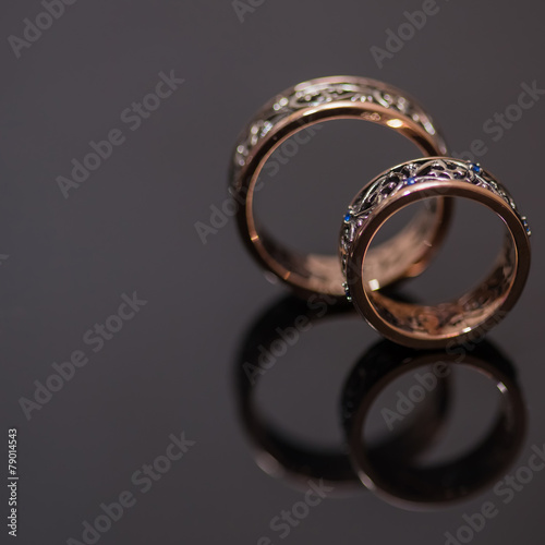 Poster Edelsteen Two wedding rings in infinity sign. Love concept.