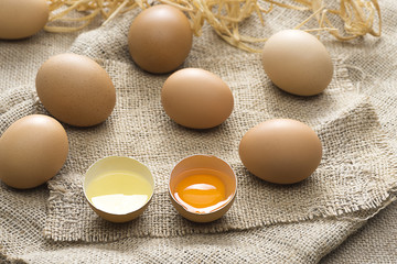 Organic eggs over jute background.