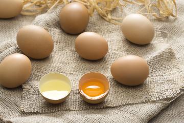 Organic eggs over jute background.