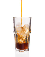 Cola glass with falling ice cubes