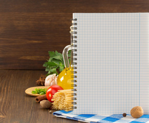 food spice and cookbook on wood
