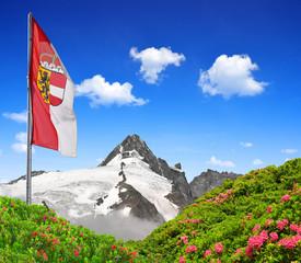 Grossglockner with flag of Salzburg ,Austria