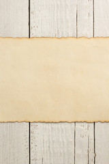 old parchmentat wooden background