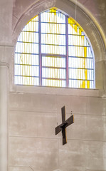 Cross Under Stained Glass Window