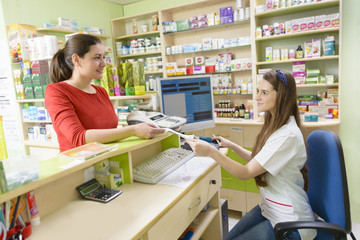 Customer in a drugstore holding a receipt